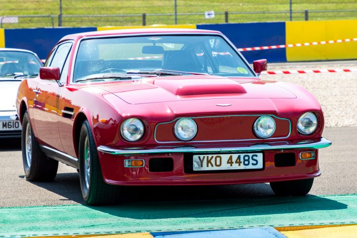 red Aston Martin AMV8 classic sports car