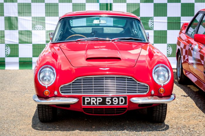 red Aston Martin classic car